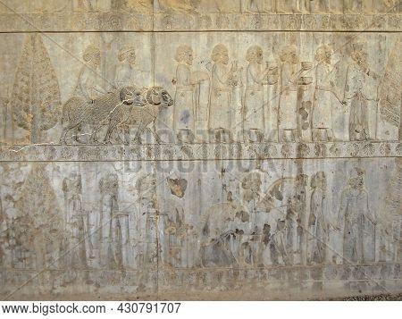 Reliefs From Apadana Palace In Persepolis, Ex-capital Of Ancient Persia, Near Shiraz, Iran. Bas-reli