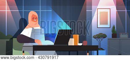 Arab Businesswoman Freelancer Working On Laptop Arabic Woman Sitting At Workplace In Dark Night Home