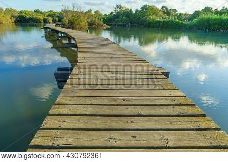 View Of An Elevated Pathway Over A Pond, In The Wetland Nature Reserve Of En Afek, Northern Israel