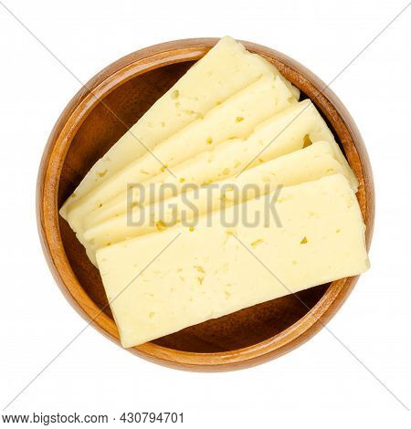 Tilsit Cheese Slices, In A Wooden Bowl. Sliced Tilsiter Cheese, A Pale Yellow Semi Hard Smear-ripene