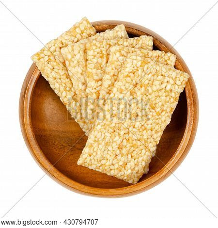 Sesame Seed Candy Bars, In A Wooden Bowl. Sesame Brittle Or Crunch, A Confection Of Sesame Seeds And