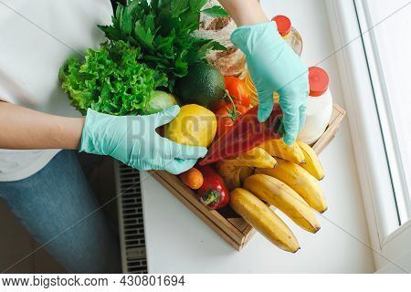 Woman With Gloves Unpack Product. Organic Product. Self-isolation Concept.