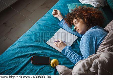 Woman Sleeping. Modern Woman Lifestyle. Tired Woman Sleeping In Pajamas
