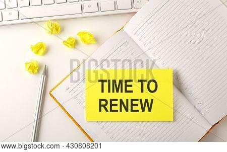 Time To Renew Text On Sticker On Diary With Keyboard And Pencil