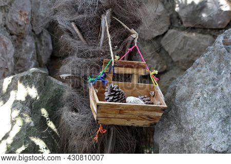 Decorative Retro Vintage Old Wooden Box Filled With Dried Pine Cones And Small Rocks Hang With Color