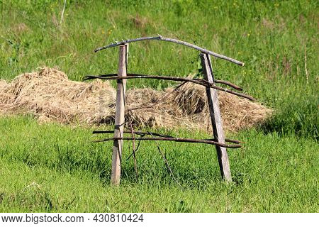 Old Wooden Support Frame Made Of Dry Wooden Boards And Sticks Used As Support For Freshly Planted Tr