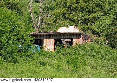 Unfinished Red Building Blocks Suburban Family House Destroyed During War With Missing Windows And L