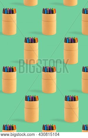 Colored Crayons Pattern Composition On Pastel Green Background. Waxy Pencils Eco Cardboard Box Isome