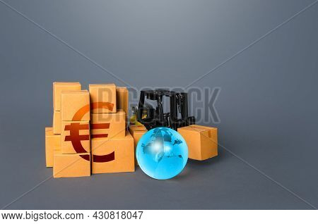 Forklift Truck And Boxes With Euro Symbol. Trade And Transportation Of Goods. Business Globalization