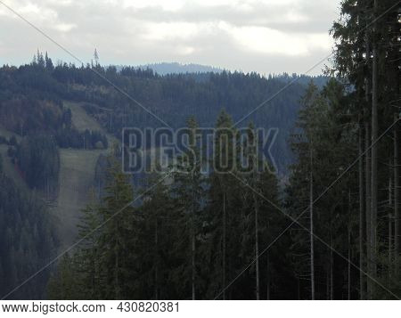 Mountainous Nature In Dull Weather. Rainy Cloudy Weather In Beskydy Mountains. Forests And Meadows D