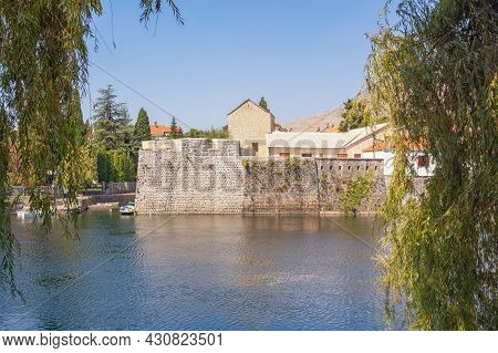 Ancient Walls Of The Old Town Of Trebinje City On A Sunny Day. Riverbank Of Trebisnica River. Bosnia