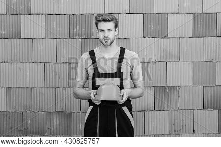 Safety Is Main Point. Building And Construction. Man Builder In Work Clothes. Man Build House. Skill