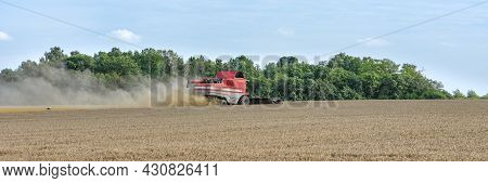 Harvest Season, Combine For Harvesting A Wheat Field. Combine Harvester Is An Agricultural Machine T