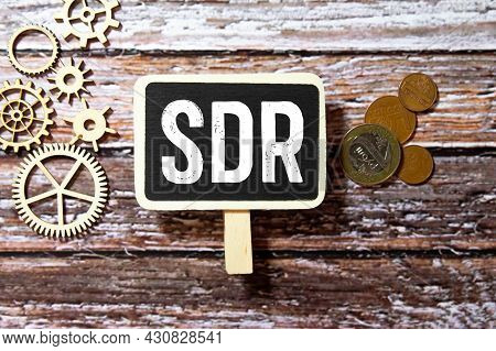 Sdr Special Drawing Rights Is The Acronym Behind Torn Office Paper With Numbers.