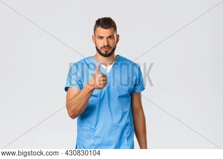 Healthcare Workers, Medicine, Covid-19 And Pandemic Self-quarantine Concept. Determined Handsome Doc