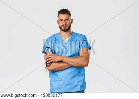 Healthcare Workers, Medicine, Covid-19 And Pandemic Self-quarantine Concept. Serious Focused Doctor,