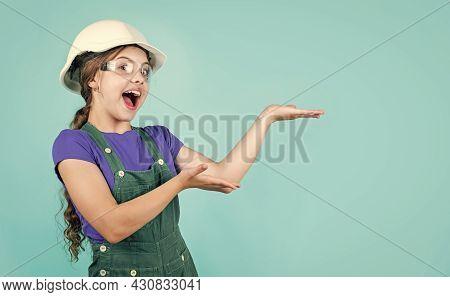 Kid Work In The Helmet. Little Girl In A Helmet. Girl Making Repairs. Teen Dressed In Hard Hat. Chil