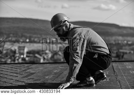Builder Use Roof Tile. Professional Master Repair Roof. Flat Roof Installation. Roofer In Special Pr