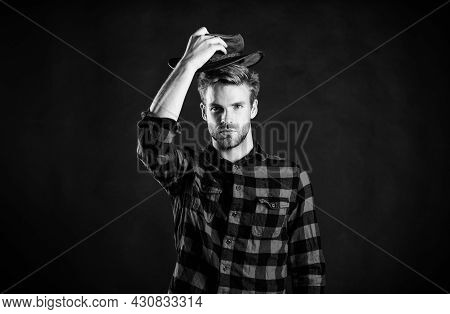 Man Unshaven Cowboy Black Background. Masculinity And Brutality Concept. Adopt Cowboy Mannerisms As