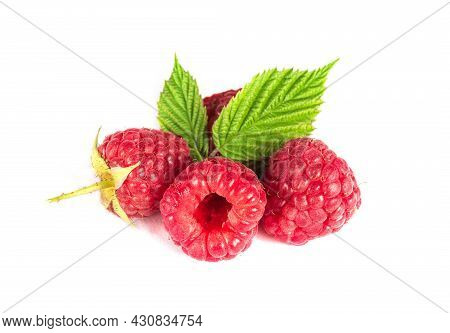 Raspberry Isolated. Raspberries With Leaf Isolate. Raspberry With Leaf Isolated On White