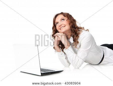 Woman With Laptop Lying Down On The Floor