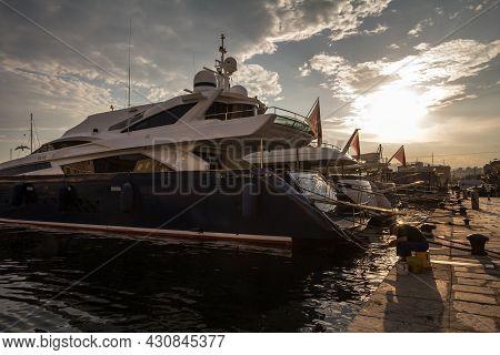 Rijeka, Croatia - June 17, 2021: Old Fisherman Fihsing On The Quay Of Rijeka Waterfront In Front Of