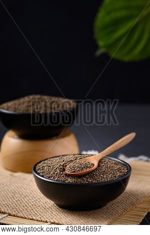 Perilla Seeds In A Black Bowl With Spoon, Healthy Herbal Seed Ingredients In Asian Food, Still Life