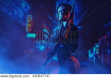 A beautiful and brave sci-fi cyborg samurai girl stands with a sword in her hands against the backdrop of the night city of the future. Game, virtual reality.