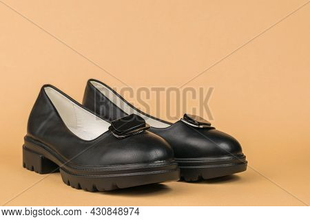 A Pair Of Leather Women's Shoes On A High Platform On A Beige Background. Fashionable Shoes.