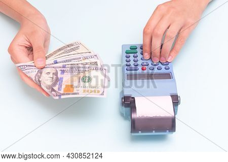 Payment For Purchases In Cash, Dollars. Close-up Of A Hand Giving Cash And Hand Typing The Amount, C