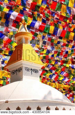 Stupa with Buddha eyes and prayer flags in Swayambhunath, Kathmandu, Nepal
