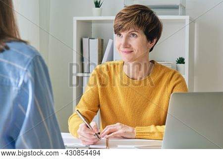 Female Psychologist Coach Talking To Patient And Taking Notes. Professional Session Of Rehab Therapy