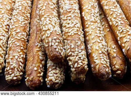 Sesame Breadsticks (grissini Al Sesamo) Close Up Isolated On Wooden Table