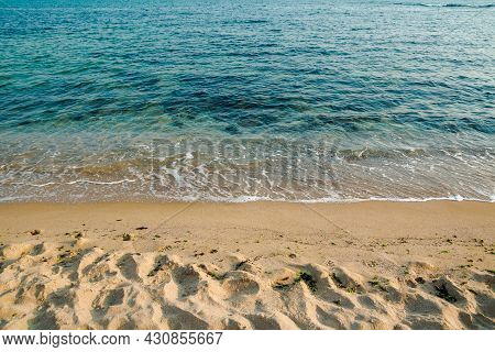Calm Morning Scenery At The Sea. Empty Sandy Beach In Morning Light. Relax And Summer Vacation Conce