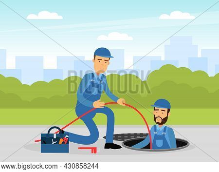 Man Plumber Wearing Blue Overall Holding Hose Looking Out Manhole Engaged In Fixing Tubes And Pipe L