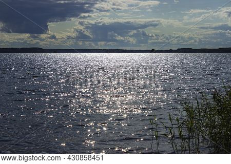 Non-transparent Water Surface Of A Lake Or River With Slight Ripples Throughout The Entire Frame