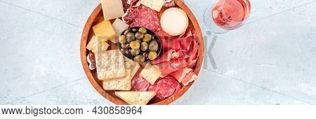 Charcuterie And Cheese Plate Panorama, Shot From The Top With Rose Wine. Cold Meats, Blue Cheese, Ol