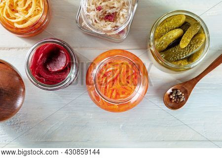 Fermented, Probiotic Food. Canned Sauerkraut, Carrot, Pickles And Other Preserves In Mason Jars. Hom
