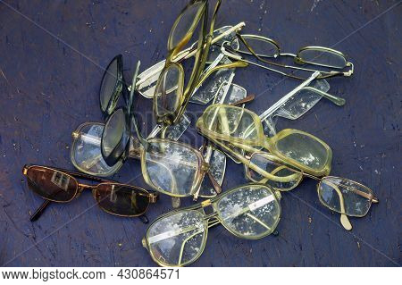 Collection Of Retro Eyewear In Mess On Blue Background