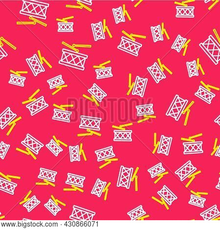 Line Musical Instrument Drum And Drum Sticks Icon Isolated Seamless Pattern On Red Background. Vecto