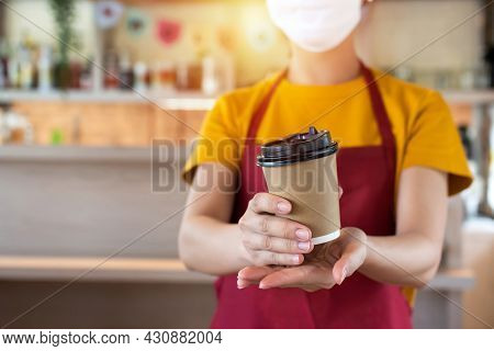 Asian Woman Staff Wearing Protection Face Mask Waiting For Serving Hot Black Coffee Cup To Customer