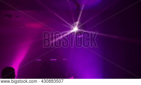 Party Atmosphere With Disco Ball. Light Beams Reflecting From A Disco Ball.