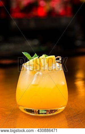 Tropical Lemonade With Mango And Mint In Glasses On Old Wooden Background