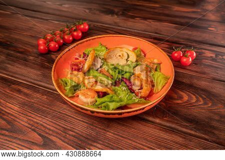 Caesar Salad With Chicken With Grated Cheese And Cherry Tomatoes