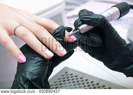 Beautician Salon, Manicure. Professional Hardware Manicure Using Electric Machine In Beauty Salon. M