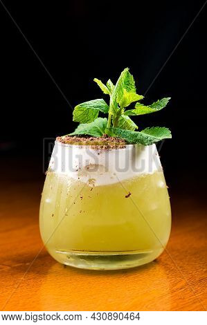 Cocktail With Kiwi And Mint In A Glass On A Wooden Background