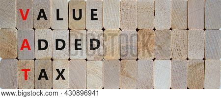 Vat, Value Added Tax Symbol. Wooden Blocks With Concept Words 'vat, Value Added Tax'. Beautiful Wood