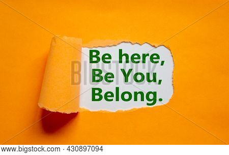 You Belong Here Symbol. Words 'be Here, Be You, Belong' Appearing Behind Torn Orange Paper. Orange B