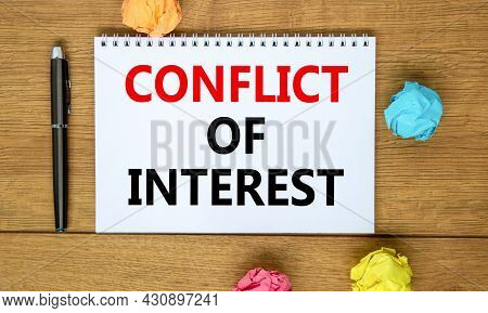Conflict Of Interest Symbol. Words 'conflict Of Interest' On Beautiful Wooden Table, Colored Paper,