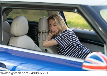 Exhausted Woman Sleep Inside Car On Driver Seat. Unhappy Poor Female Tired Fall Asleep On Parking Af